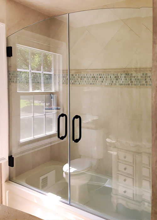 Double shower doors and sliding doors showerman for Bathroom with two doors